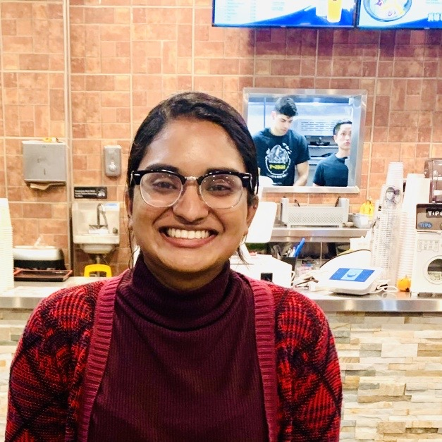 A picture of me (Sruthi) at a restaurant, taken by my friend Catherine Han!